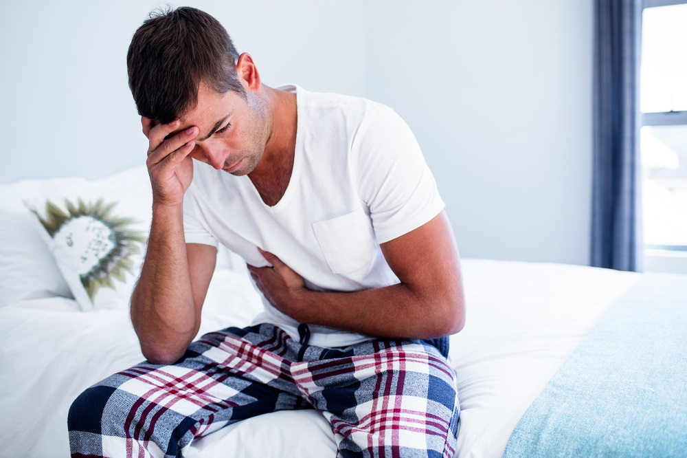 Man with pain in the stomach