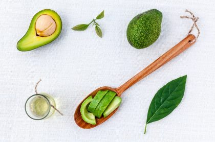 Healthy fats and avocado on white background