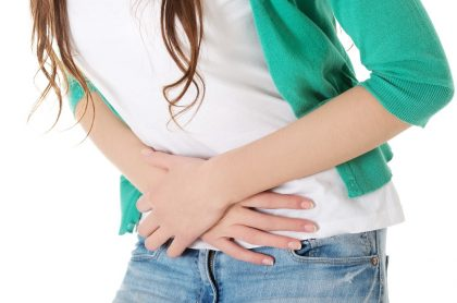 Woman holding her stomach with Indigestion