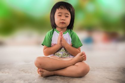 Small girl meditating