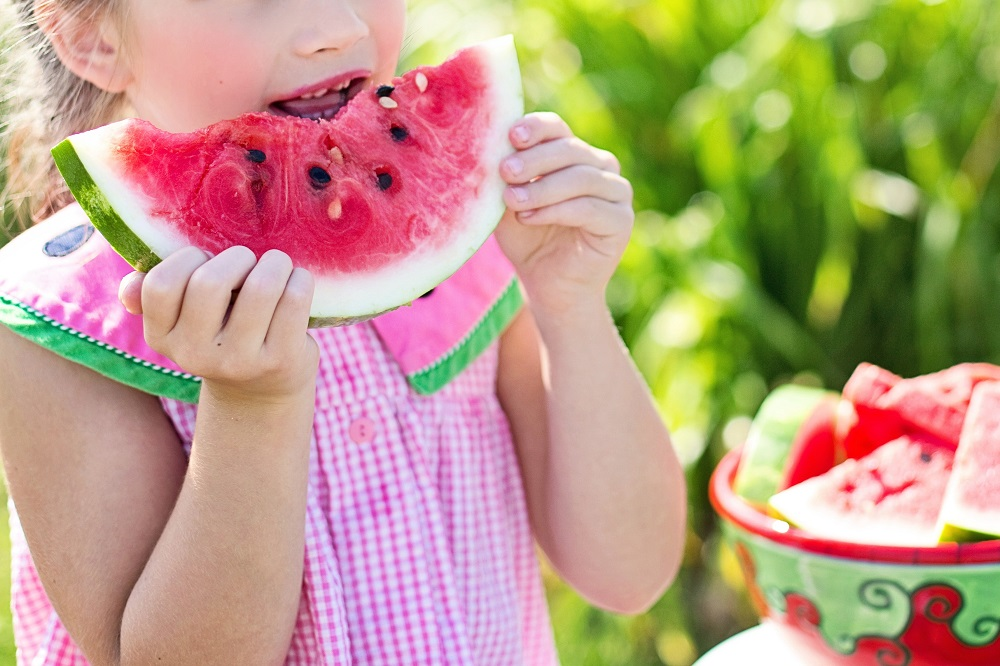 A girl eating watermelon