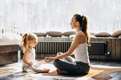 Mother and daughter meditating together to reduce stress